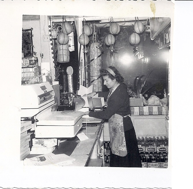 Emilia slicing ham at the grocery store in Flushing, NY in 1948