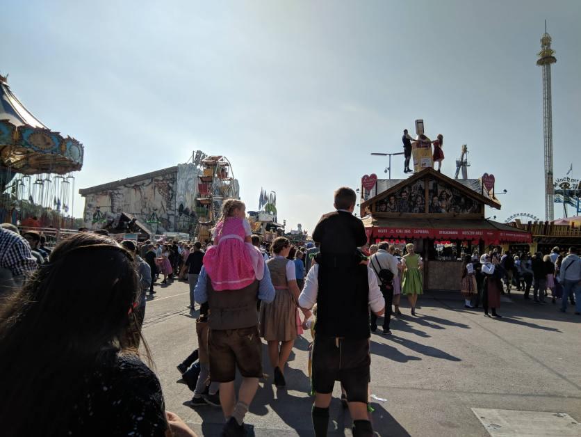 Kids riding on parent's shoulders at Munich's annual Oktoberfest festival