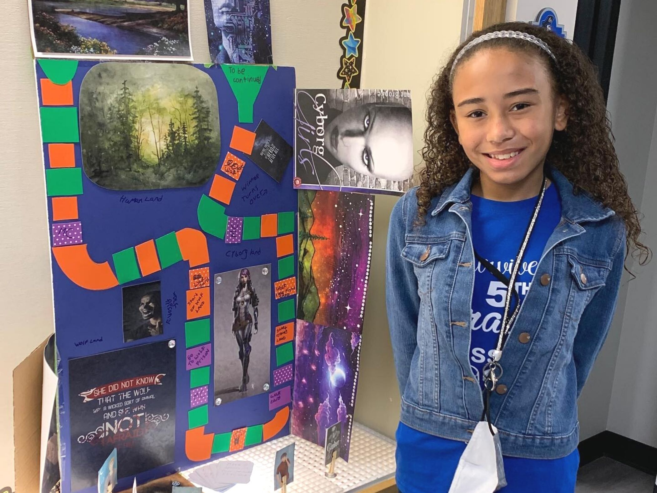 Student posing next to her project