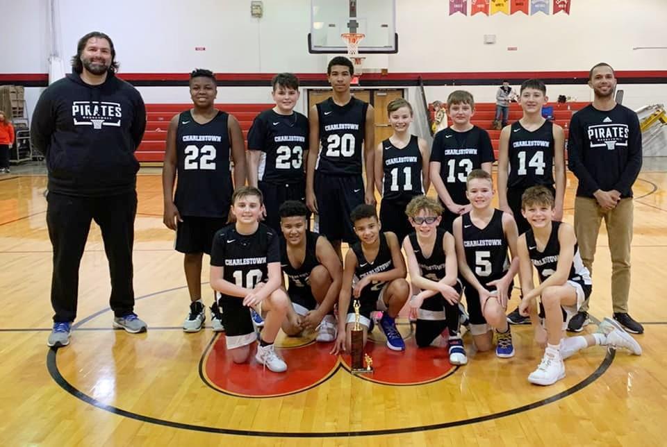 Boys basketball team pose for photo