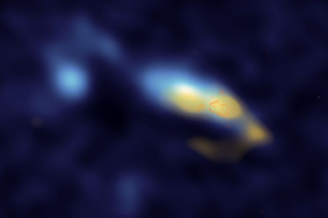 In the galaxy II Zw 40, dust (shown in yellow) is strongly associated with clusters of stars (shown in orange). UCLA researchers have used new observations of this galaxy to confirm that these stars are creating enormous amounts of dust.