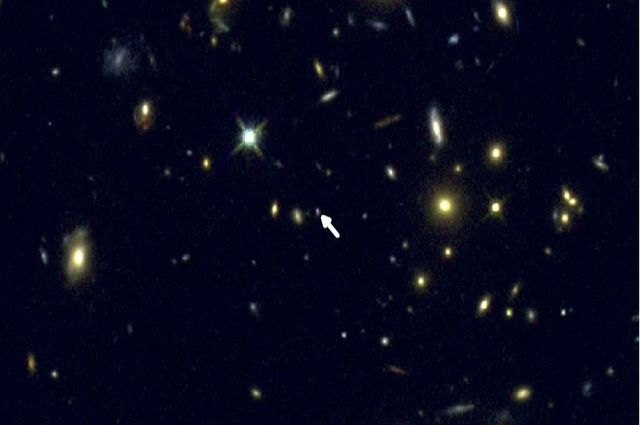 UCLA astronomy graduate student Ryan Sanders discovered a way to precisely measure oxygen in distant galaxies like COSMOS-1908, indicated by the arrow.