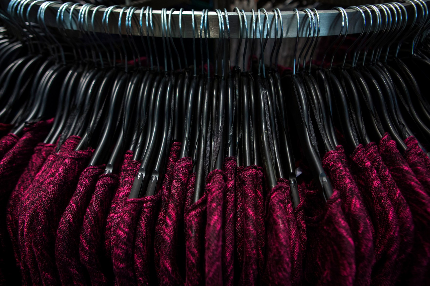 Sweaters are seen on a rack at H&M on Thanksgiving Day in New York November 28, 2013.