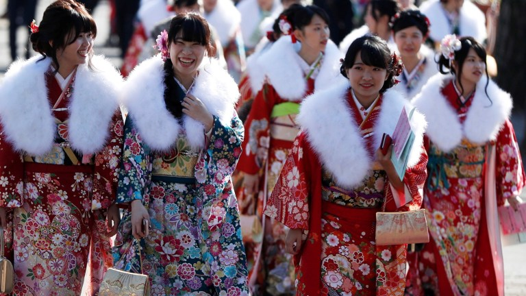 Japanese women wearing kimonos attend their Coming of Age Day celebration ceremony at Toshimaen amusement park in Tokyo