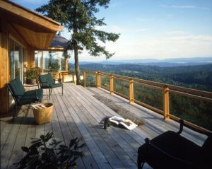 grey cedar deck, transparent stain, outdoor mountainous patio, cedar siding