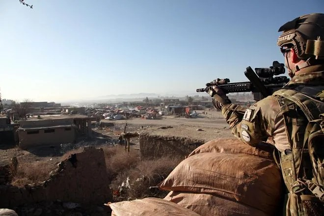 A Soldier with the Asymmetric Warfare Group, provides security from an observation post overlooking the Kholbesat bazaar, in Khowst province, Afghanistan, March 13, 2011.