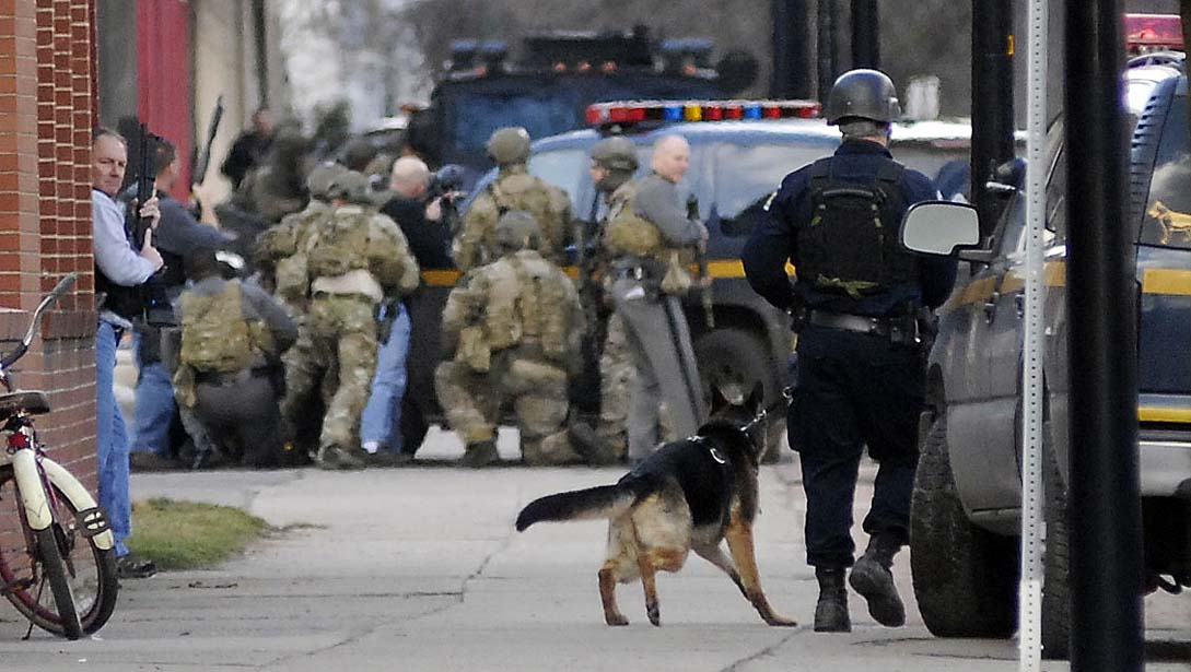 Members of HRT (in Multicam), supported on the ground by local SWAT and state tactical teams.