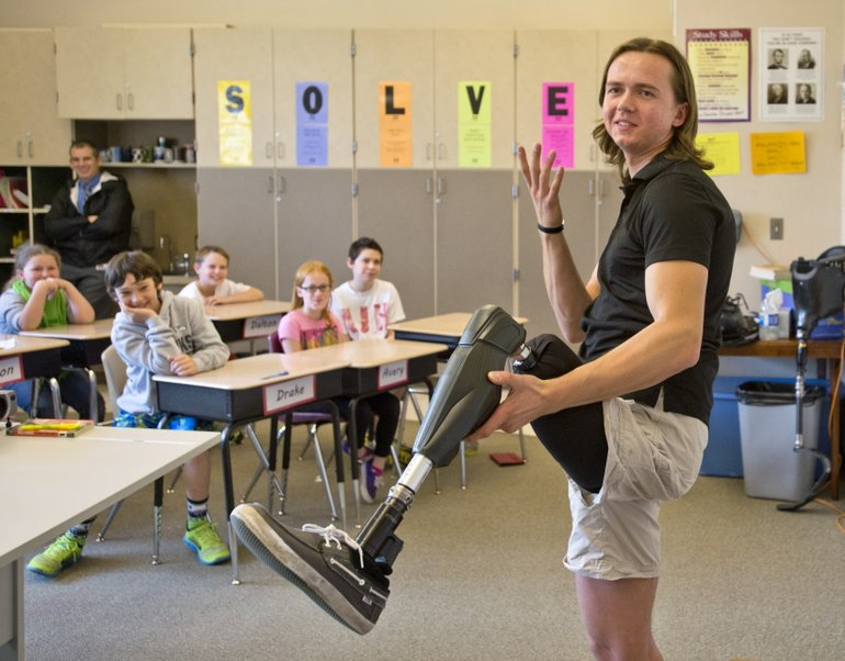 Edward Lychik talks to fifth- and sixth-graders at Maplewood Elementary School in Puyallup on April 9. (Peter Haley/AP)