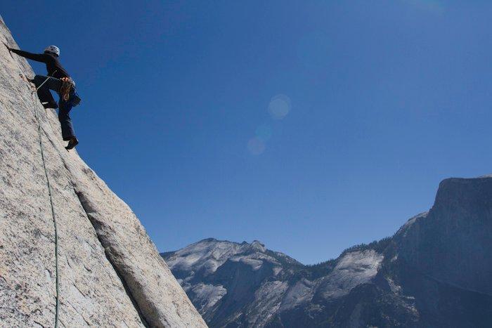 "Leading ""crest jewel"" up Yosemite's North Dome."
