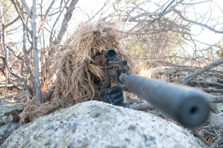 SEAL sniper properly concealed with clear bullet path. Photo courtesy U.S. Navy.