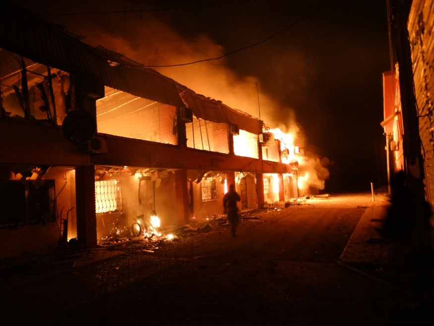 An apartment block burns in Shyrokyne as a result of pro-Russian separatist shelling. Image courtesy of author.