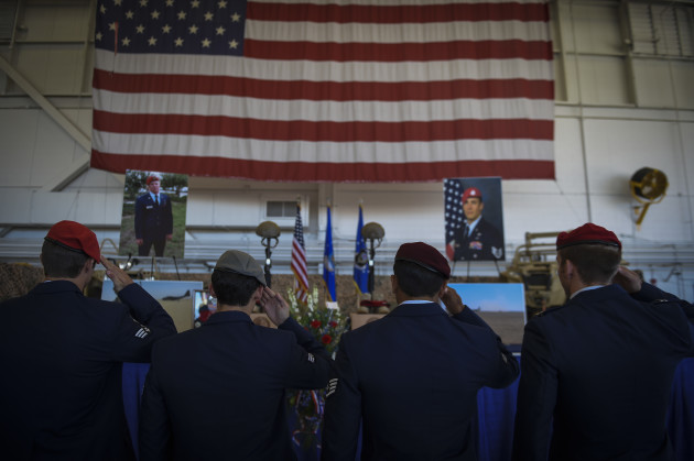 Airmen salute during Capt. Matthew D. Roland and Staff Sgt. Forrest B. Sibley's memorial service,Sept. 14, 2015, at Hurlburt Field, Fla. More than 1000 friends and family members from across the country gathered together to mourn the loss of Capt. Matthew Roland, a special tactics officer from 23rd Special Tactics Squadron, and Staff Sgt. Forrest Sibley, a combat controller from the 21st Special Tactics Squadron, at the Freedom Hangar on Hurlburt Field, Fla., Sep. 14, 2015. The two Special Tactics Airmen, who had recently deployed to Afghanistan in support of Operation Freedom's Sentinel, were shot at a vehicle checkpoint at Camp Antonik, Afghanistan, Aug. 26, and died of wounds sustained in the attack, were honored in a private memorial. Both Special Tactics Airmen will be buried with full military honors. (U.S. Air Force photo by Senior Airman Ryan Conroy/Released)