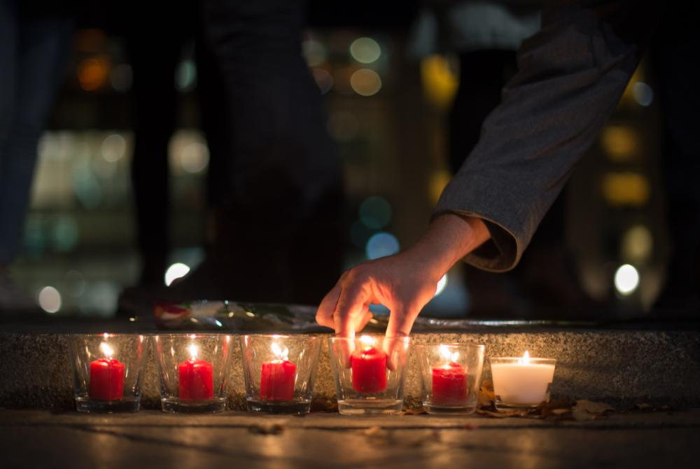 People light candles in tribute to the victims of the Paris attacks, outside the French embassy in Berlin, Germany. (Lukas Schulze/EPA)