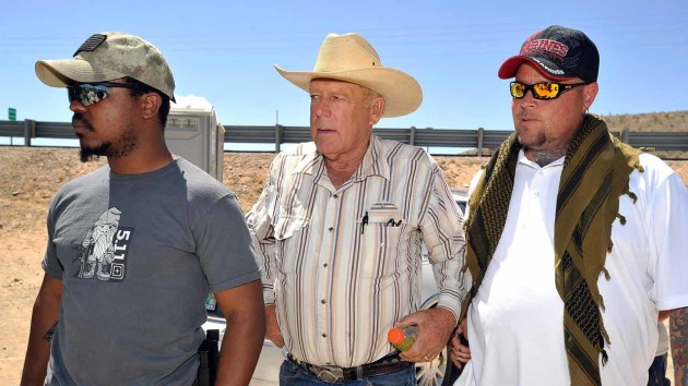 BUNKERVILLE, NV - APRIL 24: Rancher Cliven Bundy (C) arrives with body guards before a news conference near his ranch on April 24, 2014 in Bunkerville, Nevada. The Bureau of Land Management and Bundy have been locked in a dispute for a couple of decades over grazing rights on public lands. (Photo by David Becker/Getty Images)