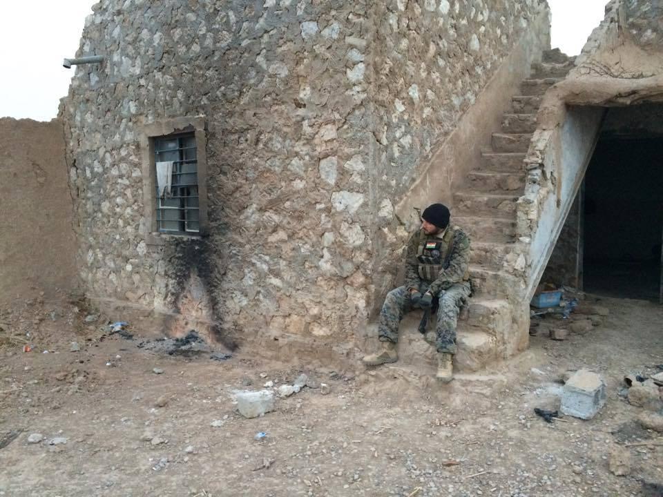 Kurt enjoys a quiet moment in a Pesh OP, formerly a Daesh village