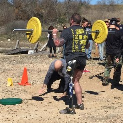 Veterans and team SAR founders Dale King (about to start a push-up) and Derick Carver (lifting).