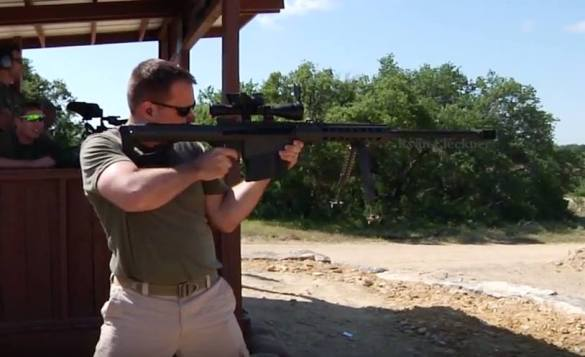 Ryan Cleckner makes a 1000 yd standing first round hit on the TV show, Top Shot. Image used with permission of Ryan Cleckner