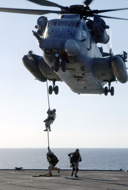 030117-N-0000K-001 At sea aboard USS Mount Whitney (LCC/JCC 20) Jan. 17, 2003 -- A U.S. Navy SEAL (SEa, Air, and Land) fast-ropes from an MH-53 ÒPave LowÓ helicopter during a Maritime Interception Operation (MIO) training exercise. U.S. Navy SEALs are deployed throughout the world conducting missions in support of Operation Enduring Freedom. U.S. Navy photo by Petty Officer 2nd Class George R. Kusner. (RELEASED)