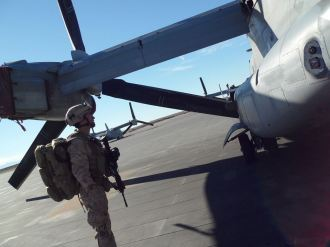 SARC standing-by to load MV-22 Osprey prior to Compound Raid training in EMV.