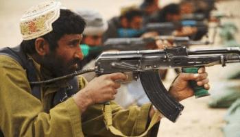 Afghan Local Police firing weapon