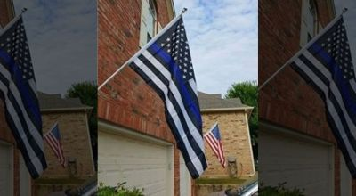 "Homeowner told to remove ""noxious & offensive"" pro-police flag"