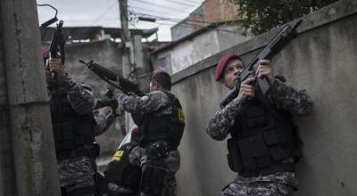 Olympic security officer shot in the head after wrong turn into slum