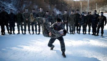 South Korean, U.S. Marines tussle in snow in what North brands 'madcap' drill