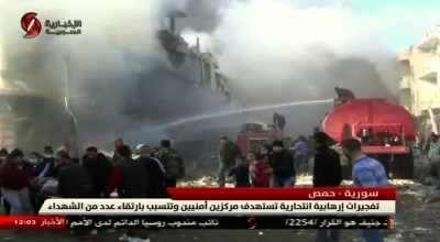 Blasts in Syria kill dozens at security headquarters in Homs