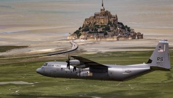 Air Force Brig Gen Richard G Moore Jr flies a C-130J Super Hercules past Mont Saint-Michel in Normandy