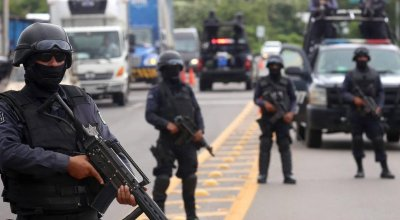 At least 14 killed in gunfight in drug-plagued northern Mexico state