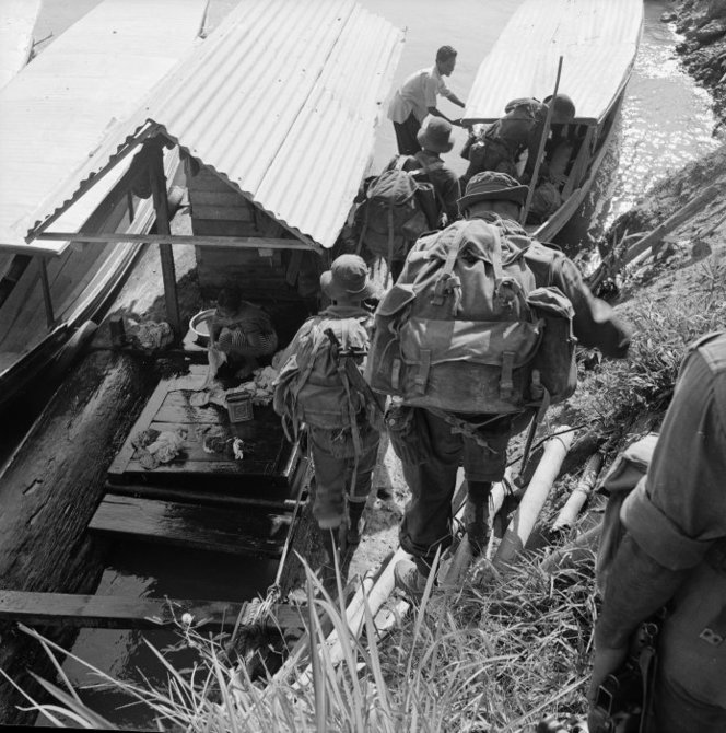 A New Zealander river patrol in Malaya.