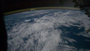 Space Shuttle Atlantis seen re-entering Earth's Atmosphere from Space Station
