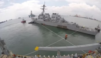 Watch: Damaged USS John S. McCain loaded onto heavy transport ship for repairs