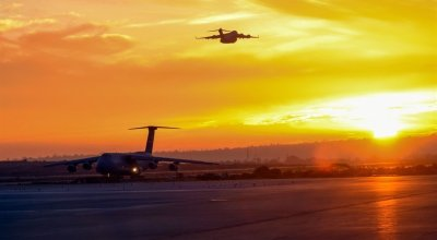 Air Force C-5M Super Galaxy lands as a C-17 Globemaster III takes off