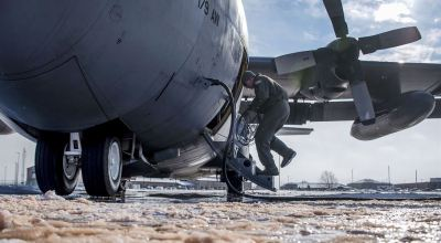 Picture of the Day: Air Force Tech. Sgt. Chris Brandal Inspects a C-130H Hercules in Bitter Cold