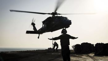 Picture of the Day: Sailors Attach Cargo to an MH-60S Seahawk Helicopter