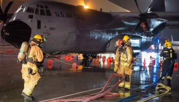 Firefighters Respond to Simulated C-130 Hercules Emergency