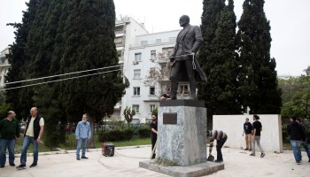 Greek Communist Party members attempt to topple statue of Harry Truman