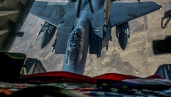 F-15E Strike Eagle Re-fueling from a KC-10 Extender Somewhere in Southwest Asia