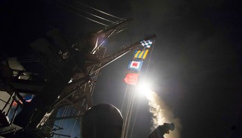 USS Ross (DDG 71) fires a tomahawk land attack missile
