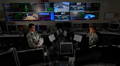Staff Sgt. Alex Garviria, 721st Communication Squadron senior systems controller, and 2nd Lt. Rachel James, 721st CS crew commander, work in the Global Strategic Warning and Space Surveillance System Center at Cheyenne Mountain Air Force Station, Colo., Sept. 2, 2014. The 721st CS provides continuous monitoring of strategic missile warning systems to ensure constant dataflow of key information to National Command Authorities, North American Aerospace Defense Command, U.S. Northern Command, U.S. Strategic Command, Air Force Space Command, and strategic and theater commanders. | U.S. Air Force photo by Airman 1st Class Krystal Ardrey