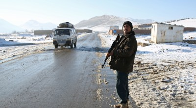 "Featured image: In this Thursday, Jan. 9, 2014 photo, Habibullah, an Afghan policeman stands guard at a check post in Kabul-Bamiyan road, on the outskirts of Maidan Shahr, capital of Wardak province Afghanistan. Locals call it ""Death Road."" The 30 kilometer (18 mile) stretch of road heading west from here has seen so many beheadings, kidnappings, and other Taliban attacks in recent years that it's become a virtual no man's land, cutting off the Hazara minority from their homeland in Afghanistan's rugged mountainous center. 