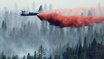 Take a ride in the cockpit of a C-130 fighting one of California's biggest wildfires ever