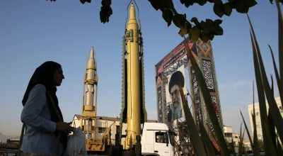 A Ghadr-H missile, center, a solid-fuel surface-to-surface Sejjil missile and a portrait of the Supreme Leader Ayatollah Ali Khamenei are displayed at Baharestan Square in Tehran, Iran, on Sunday, Sept. 24, 2017, for the annual Defense Week which marks the 37th anniversary of the 1980s Iran-Iraq war. The elite Revolutionary Guard unveiled the country's sophisticated Russian-made S-300 air defense system to the public for the first time. (AP Photo/Vahid Salemi)