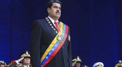In this photo provided by the Miraflores Presidential Palace, President Nicolas Maduro stands at attention during a event marking the 81st anniversary of the National Guard, in Caracas, Venezuela, Saturday, August 4, 2019. Venezuela's government says several explosions heard at a military event were an attempted attack on President Maduro. Information Minister Jorge Rodriguez said in a live broadcast that several drone-like devices with explosives detonated near the president. He said Maduro is safe and unharmed but that seven people were injured/ (Miraflores Presidential Palace via AP)