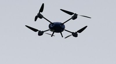 A police drone is flown during an England soccer team training session in Chantilly, France, Sunday, June 19, 2016. England will face Slovakia in a Euro 2016 Group B soccer match in Saint-Etienne on Monday, June 20. (AP Photo/Kirsty Wigglesworth).