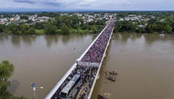 Migrant caravan approaches US border, Trump threatens action