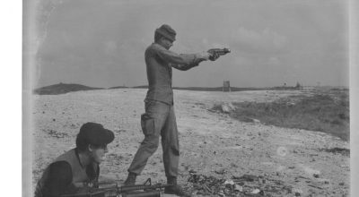 ST Idaho John S. Meyer, standing, fires a sawed-off M-79 grenade launcher on the range outside of the top-secret SOG FOB 1 base camp in Phu Bai, S. Vietnam, in late 1968. Lynne M. Black Jr., is holding his CAR-15 with an XM-148 40 mm grenade launcher attached beneath it.