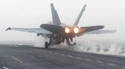 ATLANTIC OCEAN (Sept. 24, 2014) An F/A-18C Hornet assigned to the Ragin' Bulls of Strike Fighter Squadron (VFA) 37 launches from the flight deck of the aircraft carrier USS Harry S. Truman (CVN 75). (U.S. Navy photo by Mass Communication Specialist 3rd Class Karl Anderson).