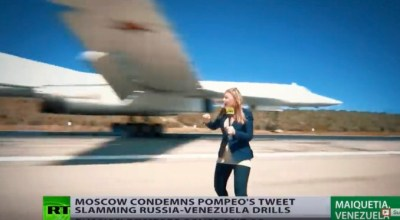 Watch: Reporter almost loses her head to a landing Russian Tu-160 bomber